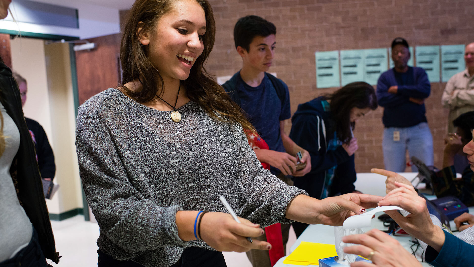 Teen checks in to vote for first time